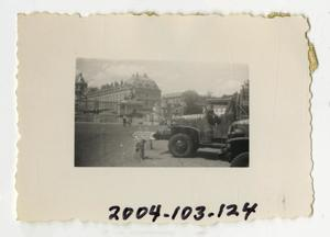 Primary view of object titled '[Photograph of Army Truck in German City]'.