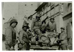 Primary view of object titled '[Photograph of Soldiers and Tank in City]'.