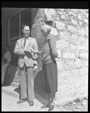 Primary view of object titled '[Mayor Mary Kyle Hartson and man standing at Fire Station]'.