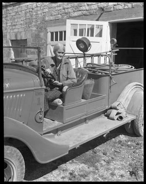 Primary view of object titled '[Mayor Mary Kyle Hartson in driver's seat of fire truck]'.