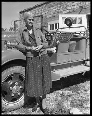 Primary view of object titled '[Mayor Mary Kyle Hartson leaning against fire truck]'.