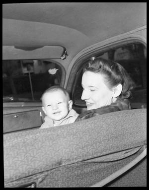 Primary view of object titled '[Woman in Car Holding Child]'.