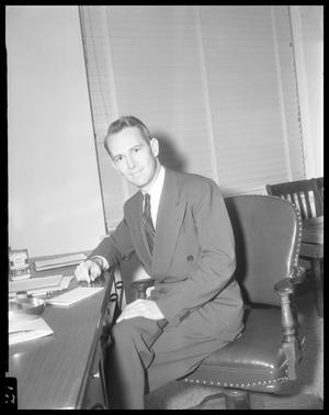 Primary view of object titled '[Vernon McGee at Desk]'.