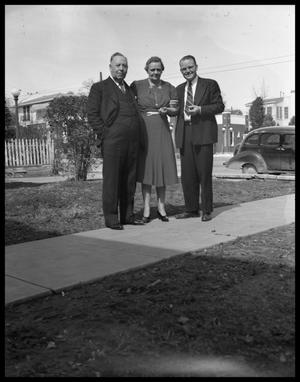 Primary view of object titled '[Two Men and Woman Standing Outside]'.