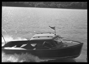 Primary view of object titled '[Boat Speeding across Water]'.