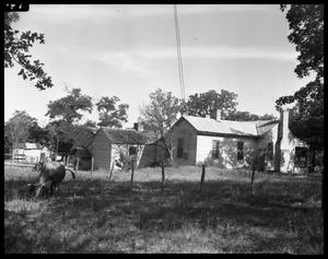 Primary view of object titled '[Back Exterior of Rural Home]'.