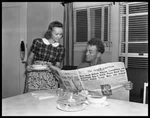 Primary view of object titled '[Man and Woman Reading Newspaper]'.