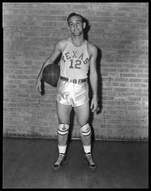Primary view of object titled '[Man Posing in Texas Basketball Uniform]'.