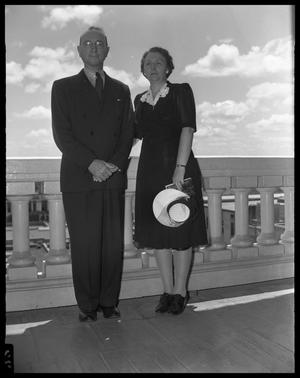 Primary view of object titled '[Man and Woman Standing on Balcony]'.