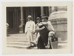 Primary view of object titled 'Senator Fairchild, Mildred and Mac Woodward on Capital steps'.