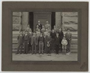 Primary view of object titled '[Walter C. Woodward and Lieutenant Governor Miller on Steps with a Group of Young Boys]'.