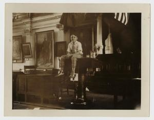 Primary view of object titled '[Walter M. Woodward Sitting on a Podium]'.