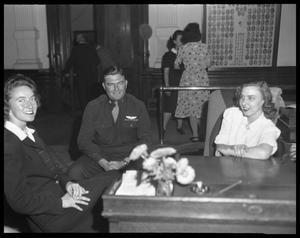 Primary view of object titled '[Man in Uniform with Two Women at 49th Texas Legislature]'.