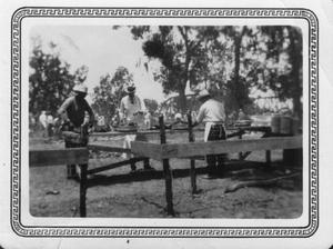 [Celebration of the opening of the Brazos River Bridge. Food preparation.]
