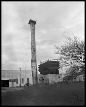 Primary view of object titled '[Demolition of smokestack]'.