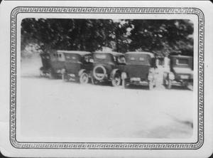 Primary view of object titled '[Automobiles lined up at opening ceremonies of the Brazos River Bridge]'.