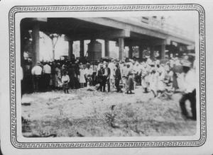 Primary view of object titled '[Brazos River Bridge opening ceremonies celebration. Large group of people standing under bridge.]'.