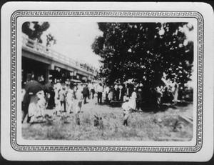 Primary view of object titled '[Celebration of the Brazos River Bridge opening ceremony. People holding dark umbrellas.]'.