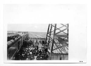 Primary view of object titled '[Soldiers Loading Burial Caskets]'.