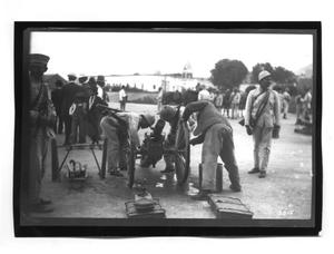 Primary view of object titled '[Prepping a Cannon for Use]'.