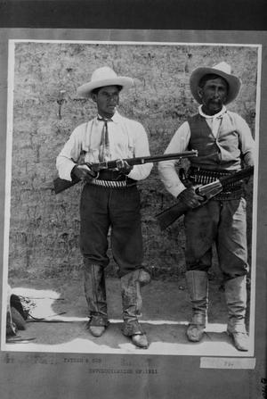 Primary view of object titled '[Father and Son with Rifles]'.