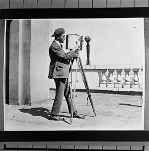 Primary view of object titled '[Cameraman Preparing Camera]'.