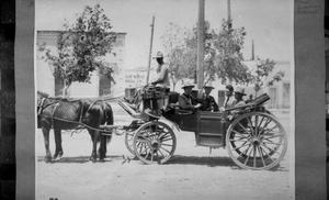 Primary view of object titled '[Men in Carriage]'.