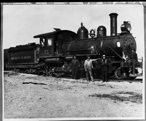Primary view of object titled '[Men Standing in Front of Train]'.