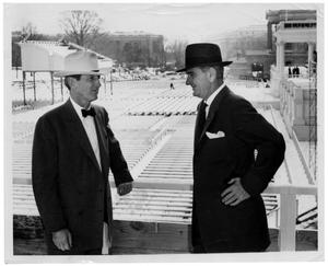 Primary view of object titled '[Lyndon Johnson and Another Man Talking Above Seating]'.