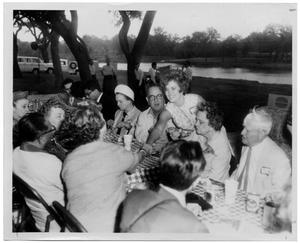 Primary view of object titled '[Lyndon Johnson and Others at an Outdoor Picnic Table]'.