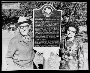 Primary view of object titled '[Otto Lindig Standing at a Historical Marker with Woman]'.