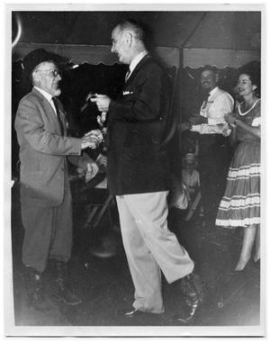Primary view of object titled '[Lyndon Johnson and Otto Lindig Shaking Hands]'.