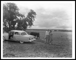 Primary view of object titled '[Lyndon and Lady Bird Johnson Standing in a Field]'.
