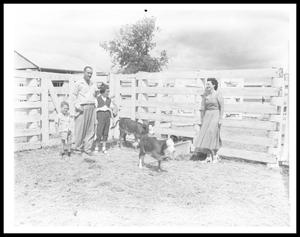 Primary view of object titled '[Johnson Family in a Pen with Calves]'.