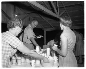 Primary view of object titled '[Lyndon Johnson Getting Food]'.