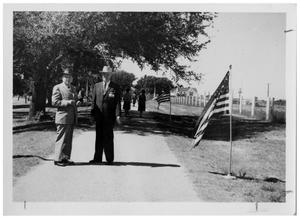 Primary view of object titled '[Two Men Standing on a Dirt Path]'.