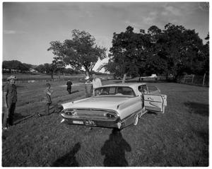 Primary view of object titled '[Lyndon Johnson with a Man by a Car]'.