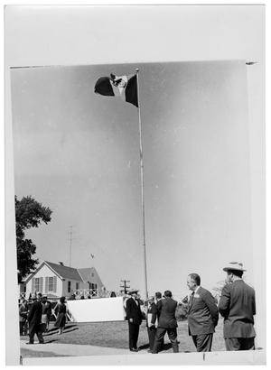 Primary view of object titled '[Lyndon Johnson and Others Under a Mexican Flag]'.