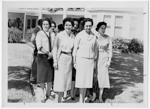 Primary view of object titled '[Lady Bird Johnson Standing with a Group of Women]'.