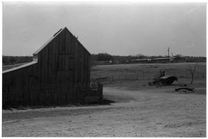 Primary view of object titled '[Barn and a Dirt Road]'.