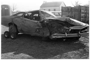 Primary view of object titled '[Wrecked Car Being Hauled]'.