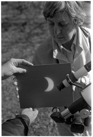 Primary view of object titled '[Projecting a Solar Eclipse Through a Telescope]'.