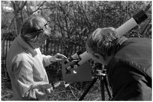 Primary view of object titled '[Two People Viewing Images of a Solar Eclipse]'.