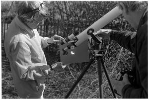Primary view of object titled '[Two People with a Telescope]'.