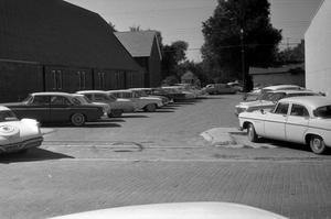 Primary view of object titled '[Cars Parked at First United Methodist Church]'.