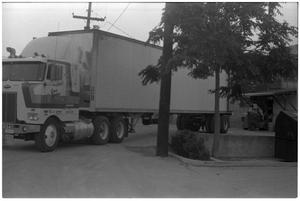 Primary view of object titled '[Truck at a Loading Dock]'.