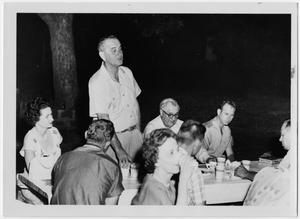 Primary view of object titled '[Lyndon Johnson Standing Among Picnickers]'.