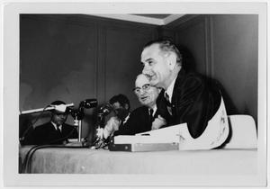 Primary view of object titled '[Harry S. Truman and Lyndon Johnson at a Microphone]'.