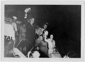 Primary view of object titled '[Lyndon B. Johnson, Lady Bird, and Others Exiting From an Airplane]'.