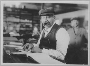 [Photograph of Gustav Schuhmann in Hardware Store]